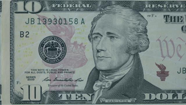 various close up shots and panning shots of a american ten dollar bill close up shots focus on the portrait of alexander hamilton on the ten dollar... - banconota da 10 dollari statunitensi video stock e b–roll