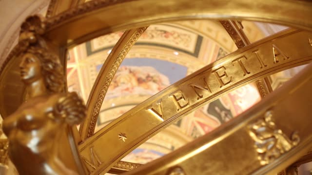 Various close up views of the golden Main Lobby Globe inside The Venetian Macao resort and casino operated by Sands China Ltd a unit of Las Vegas...
