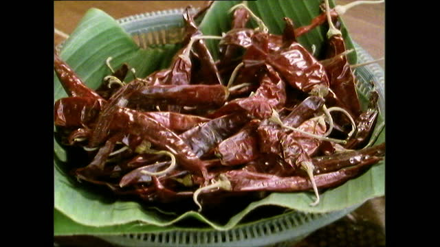 various close ups of fresh and dried chillies; 1989 - thai food stock videos & royalty-free footage