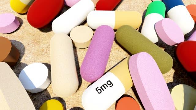 vídeos de stock e filmes b-roll de various colourful pills - vitamina a