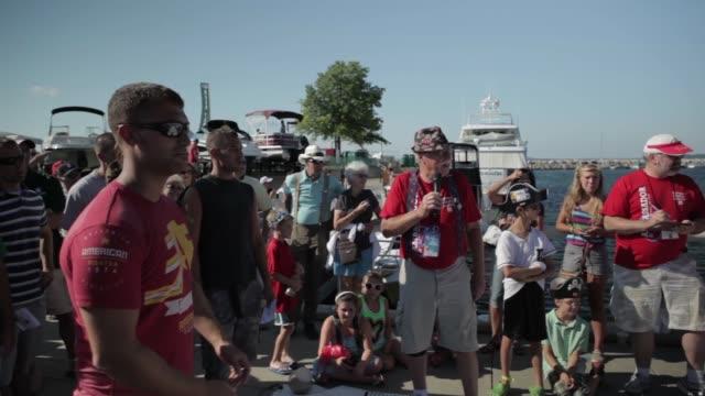 vidéos et rushes de various contestants spitting as announcer calls distances at the cherry pit spitting contest national cherry festival - traverse city
