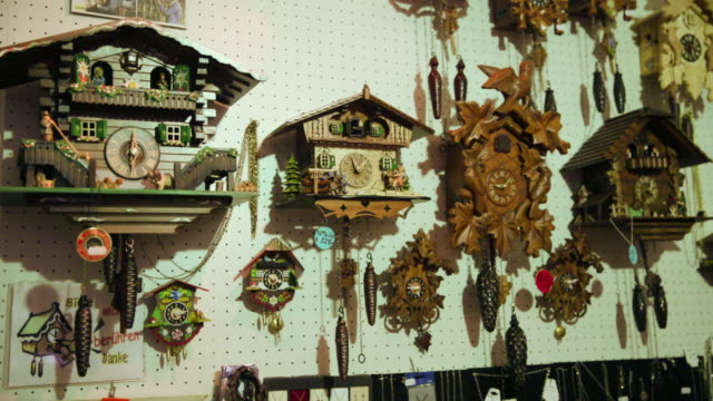 various cuckoo clocks on wall - variation stock videos & royalty-free footage
