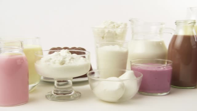 various dairy products, flavoured milks and cheeses - hergestellter gegenstand stock-videos und b-roll-filmmaterial