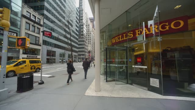 various day time lapse shots of a wells fargo branch in new york city on april 9 a wide panning shot of the entrance to a wells fargo with... - wells fargo stock videos and b-roll footage