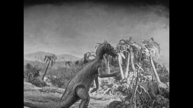 1925 Various dinosaurs interact with jungle plateau environment and each other