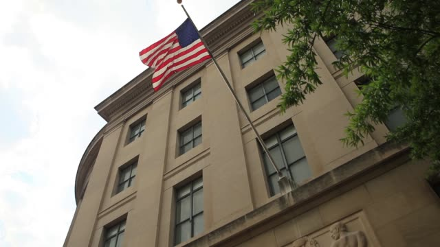 various exterior shots of federal trade commission / statues engravings and flowers by entrance / facade of building / wide shots of building facade... - federal building stock videos and b-roll footage