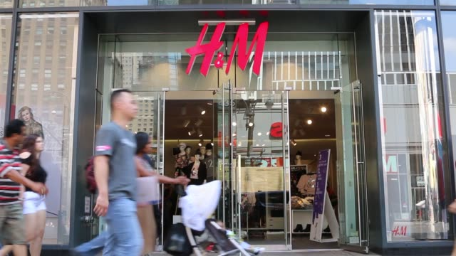 Various exteriors shots of an HM retail location in Manhattan New York as pedestrians pass by on a sunny day A wide shot of the entrance to a New...