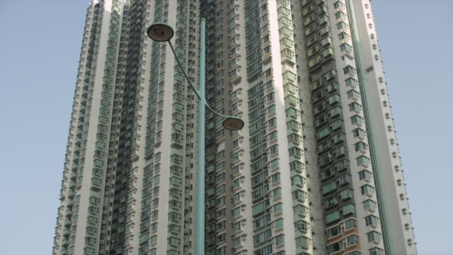 various external shots of large residential high rise buildings in hong kong - population explosion stock videos & royalty-free footage