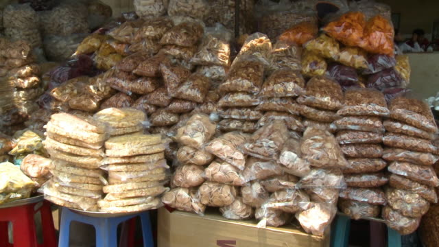 various finger foods on display in a street stall - churro stock videos & royalty-free footage