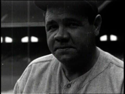 various footage of babe ruth in a yankee uniform / hitting in a game and running to first / running the bases after hitting a home run / - frivarv bildbanksvideor och videomaterial från bakom kulisserna