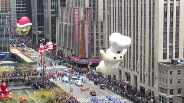 Various footage of Macy's Thanksgiving Parade floats and balloons