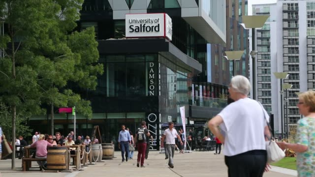various general views a university of salford building at mediacityuk, people walking past and signage, in salford quays, greater manchester, uk, on... - salford quays stock videos & royalty-free footage