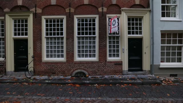various general views an estate agent's for sale sign sits on display outside a residential property in utrecht netherlands on monday oct 14 2013... - utrecht stock videos & royalty-free footage
