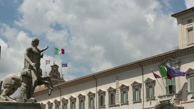 various general views an italian national flag flies on a mast inbetween the presidential standard and european union flag on the clocktower of the... - italian flag stock videos and b-roll footage
