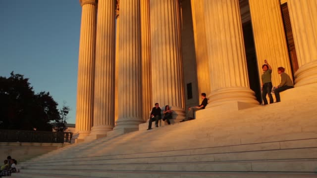 Various general views and angles of the US Supreme Court at dusk / people sitting on steps watching sunset US Supreme Court at Dusk on November 07...