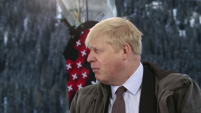 various general views boris johnson mayor of london during a bloomberg television interview on day two of the world economic forum in davos... - ダボス点の映像素材/bロール