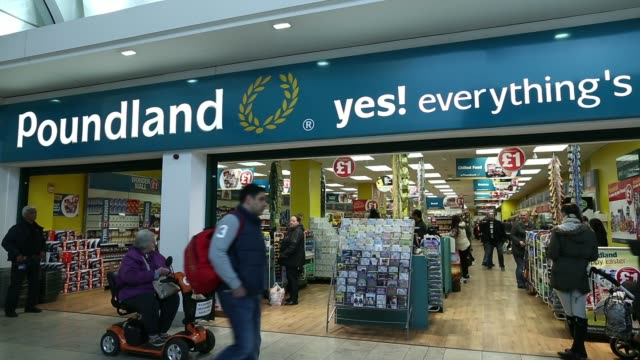 Various general views customers paying for goods at checkout desks inside a Poundland discount store operated by Poundland Group Plc in London UK on...