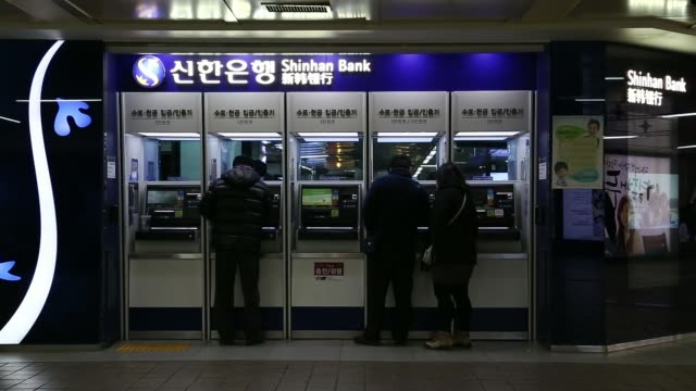 various general views customers use automated teller machines at a shinhan bank branch a unit of shinhan financial group ltd in seoul south korea on... - financial accessory stock videos & royalty-free footage