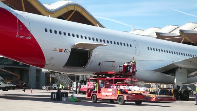 various general views groundcrew work near an airbus a330 300 jet operated by iberia airlines, a unit of international consolidated airlines group... - passagier stock-videos und b-roll-filmmaterial