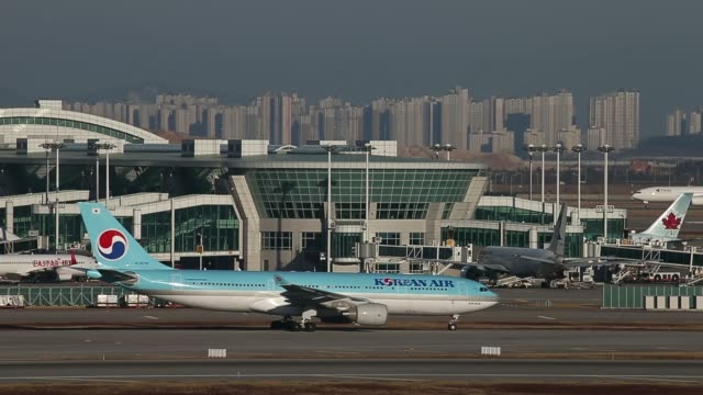 stockvideo's en b-roll-footage met various general views korean air lines co passenger aircraft taxi along the tarmac at incheon international airport in incheon south korea on sunday... - incheon