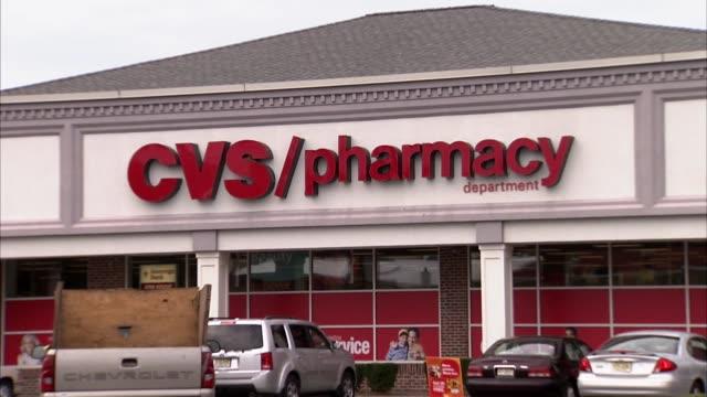 various general views of cvs pharmacy exteriors in nj suburbs cvs pharmacy on july 29, 2011 in roselle park, new jersey - cvsケアマーク点の映像素材/bロール