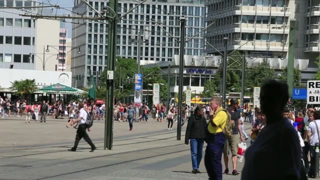 Various general views pedestrians and trams pass through Alexanderplatz square in Berlin Germany on Wednesday May 21 2014