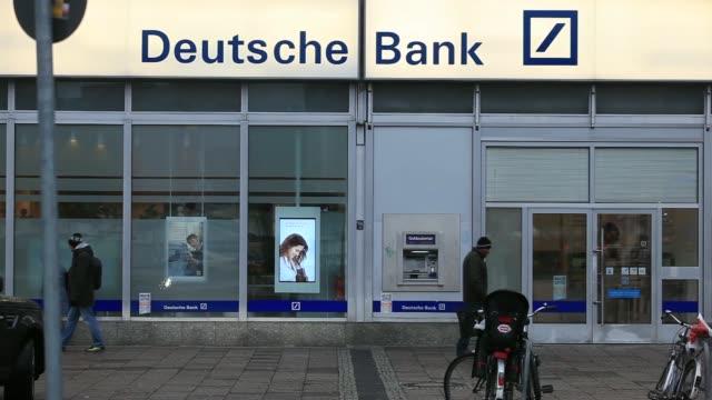 various general views pedestrians pass outside a deutsche bank ag branch in berlin germany on monday jan 20 a customer exits a deutsche bank branch... - deutsche bank stock videos & royalty-free footage