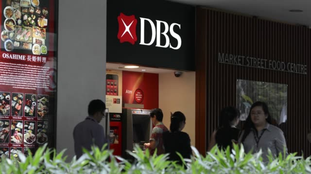 Various general views pedestrians walk past a DBS Group Holdings Ltd bank branch in Singapore on Wednesday July 31 2013 Customers use DBS Group...