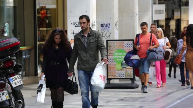 Various general views shoppers walk along Ermou Street the city centre of Athens Greece on 29 Sept 2014 Shoppers walk past a Pull and Bear store on...