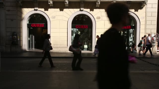 vídeos de stock, filmes e b-roll de various general views shoppers walk past a guess inc store in rome italy on monday oct 20 pedestrians walk past a 3 italia mobile phone store people... - produto interno bruto
