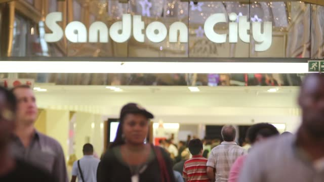 various general views shoppers walk past retail stores in the mall at sandton city center in johannesburg south africa on thursday dec 12 shoppers... - cartier video stock e b–roll