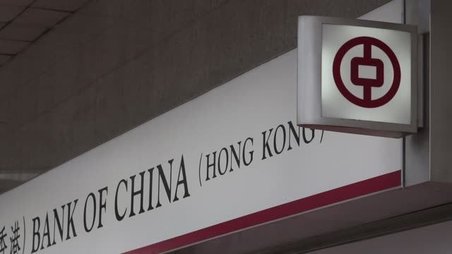 various general views signage for bank of china ltd and passing pedestrians and traffic outside one of the company's bank branches in hong kong china... - bank of china tower hong kong stock videos & royalty-free footage