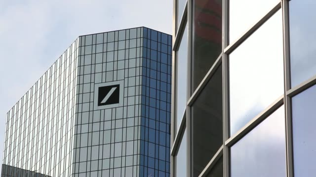 various general views the deutsche bank ag headquarters stands in frankfurt germany on monday march 24 the deutsche bank ag logo sits on the companys... - deutsche bank stock videos & royalty-free footage