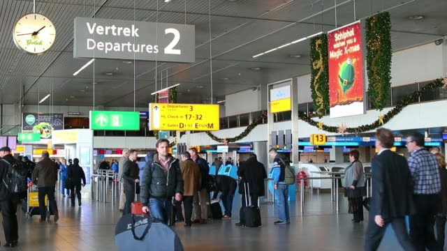 Various general views travelers pass through and use KLM selfservice check in machines operated by the Air FranceKLM Group in the departure lounge at...