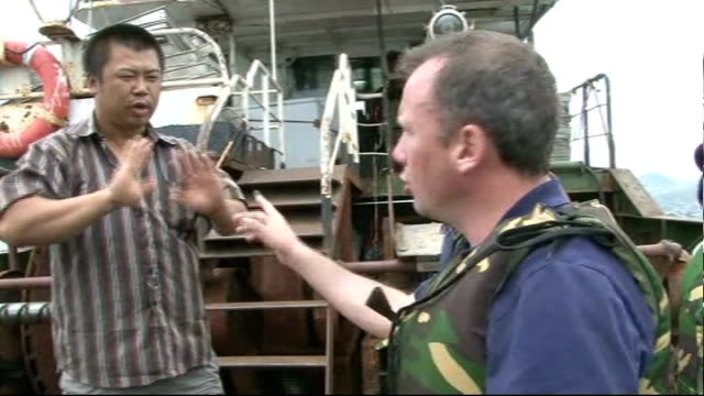 vídeos de stock e filmes b-roll de various good shots of pirate trawlers fishing int fish being sorted below decks at sea various views of reporter in dinghy with sailors from siera... - amanhar o peixe