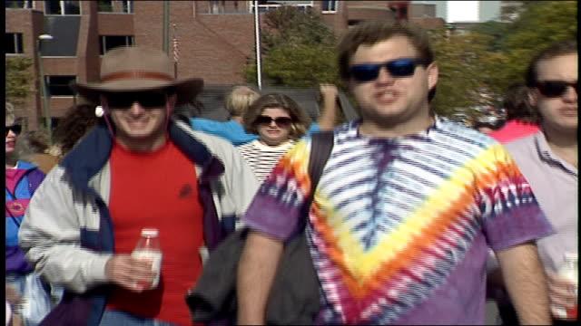 various groups of people on street in boston for head of the charles regatta - regatta stock-videos und b-roll-filmmaterial