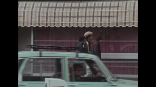 various groups of young men on southall street in 1982 - cap stock videos & royalty-free footage