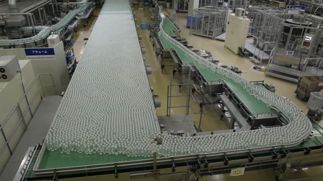 Various high angle views bottles of Wilkinson sparkling water move along the production line of the Asahi Soft Drinks Co Mount Fuji factory in...