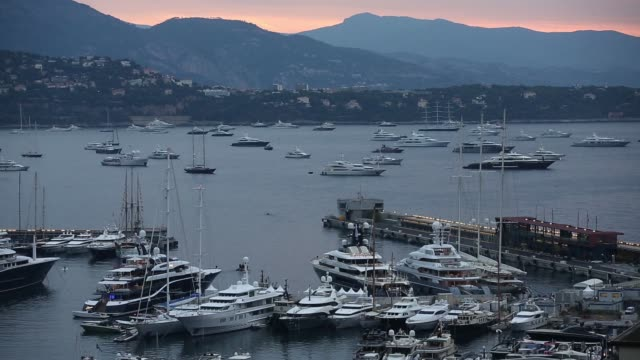 Various high angle views of superyachts and other vessels moored in the Port Hercules harbor as the sun rises ahead of day one of the Monaco Yacht...