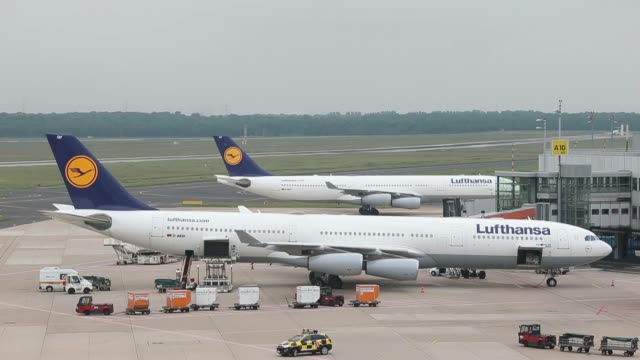 various high angle views passenger aircraft operated by deutsche lufthansa ag stand or taxi on the tarmac at dusseldorf airport operated by flughafen... - flughafen stock videos & royalty-free footage