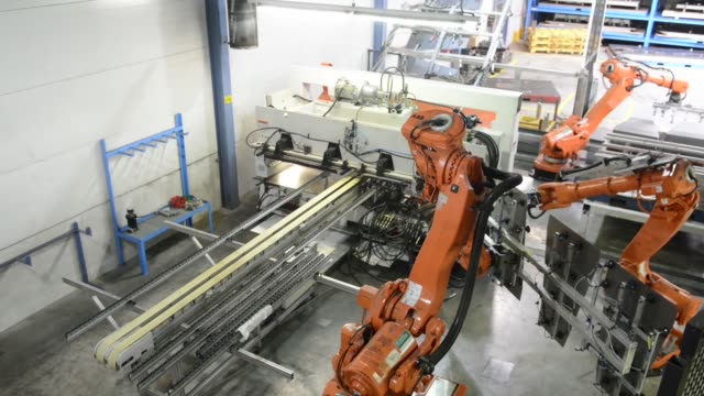Various high angle views robotic machinery producing laser welded steel blanks for use in the automotive industry at Voestalpine AG's plant in Linz...