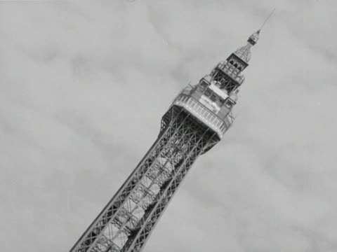 various images of blackpool including the blackpool tower and hoardings and signs for funfair attractions and food and drink concessions 1964 - blackpool stock-videos und b-roll-filmmaterial