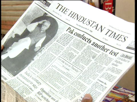 various indian publications with headlines reporting nuclear tests by pakistan. - 核兵器実験点の映像素材/bロール