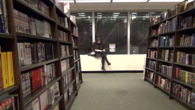 various interior shots of barnes and noble bookstore shoppers browsing through book shelves and shots of books on the shelves - barnes & noble stock videos and b-roll footage