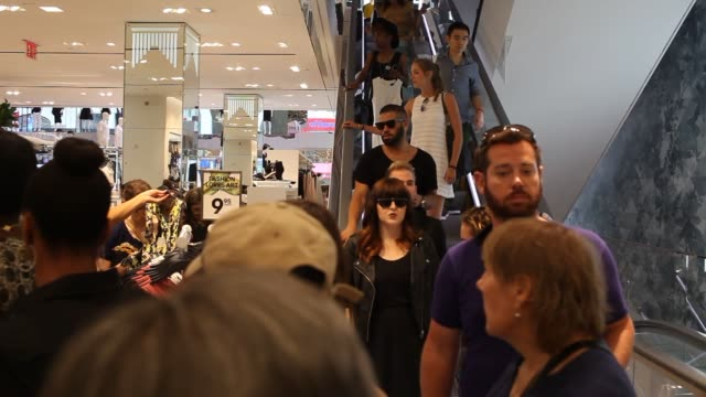 Various interior shots of customers walking through and browsing at the worlds largest flagship HM store in New York City on opening day
