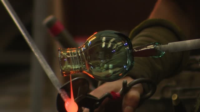 various interior shots of glassblowing glass being made in workshop by anonymous glass blowers glass vase being shaped liquid glass being drizzled... - glasbläser stock-videos und b-roll-filmmaterial