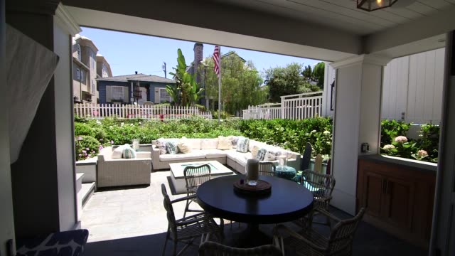 various interior shots of luxury homes and furnishings in manhattan beach california a wide panning shot of an eating area that leads out to a patio... - terrasse grundstück stock-videos und b-roll-filmmaterial