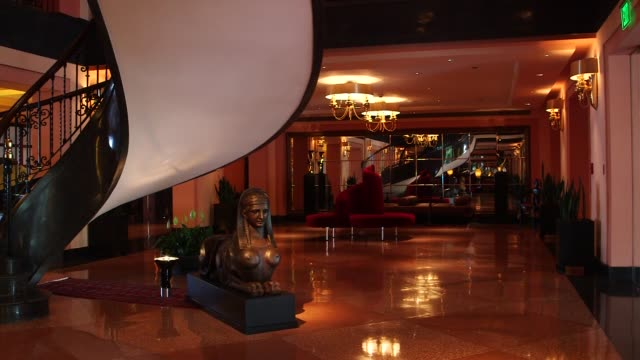 Various interior shots of the Condado Vanderbilt Hotel in San Juan Puerto Rico A wide panning shot of the lobby with a spiral staircase and...