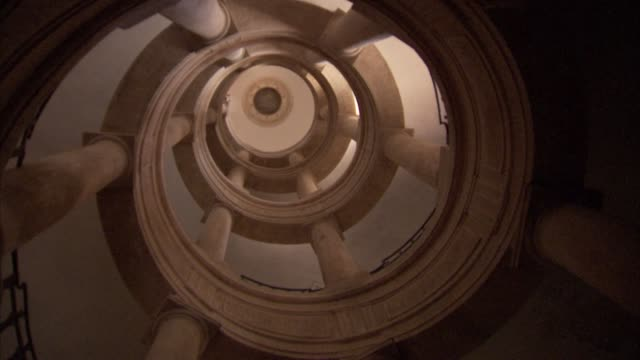 various interiors of Palazzo Mundell / Robert Mundell's 12th century castle in Siena Italy / views of various rooms / spiral staircase / historic...