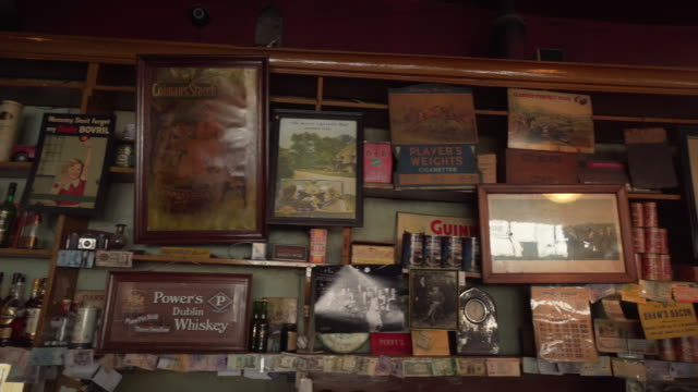 various items on wall of pub - ireland - group of objects stock videos & royalty-free footage